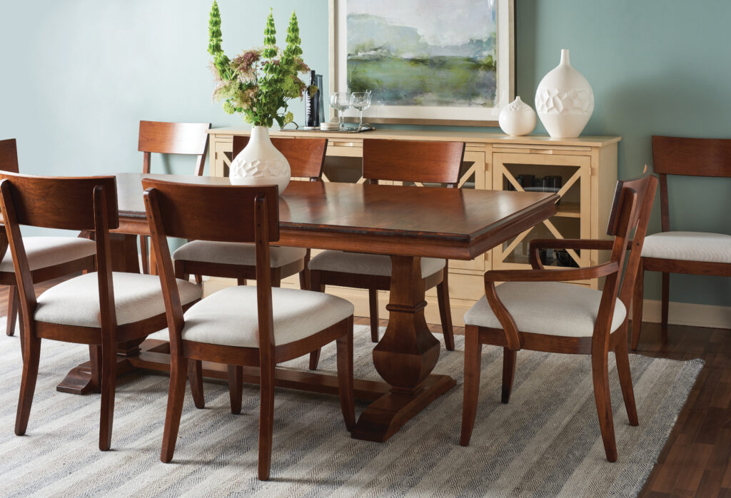 Gat Creek's Palisade dining room table and Bella chairs, both made of Cherry, add elegance to a home.