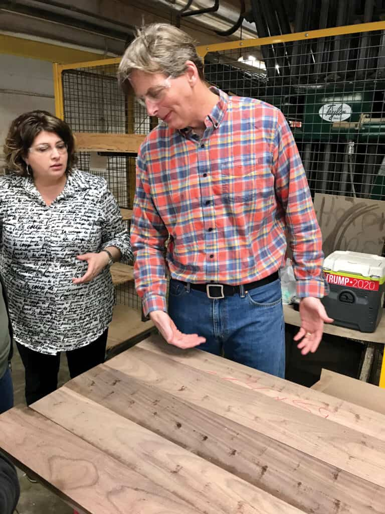 CEO Gat Caperton describes the qualities of this wood panel during a factory tour.