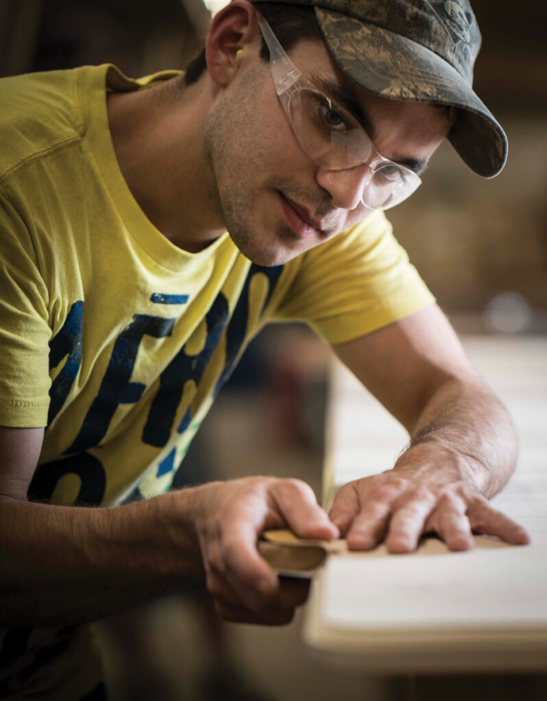 Chester Kidwell works at Gat Creek as a builder with a specialization in solving problems. In his line of work, fine sanding comes in handy.