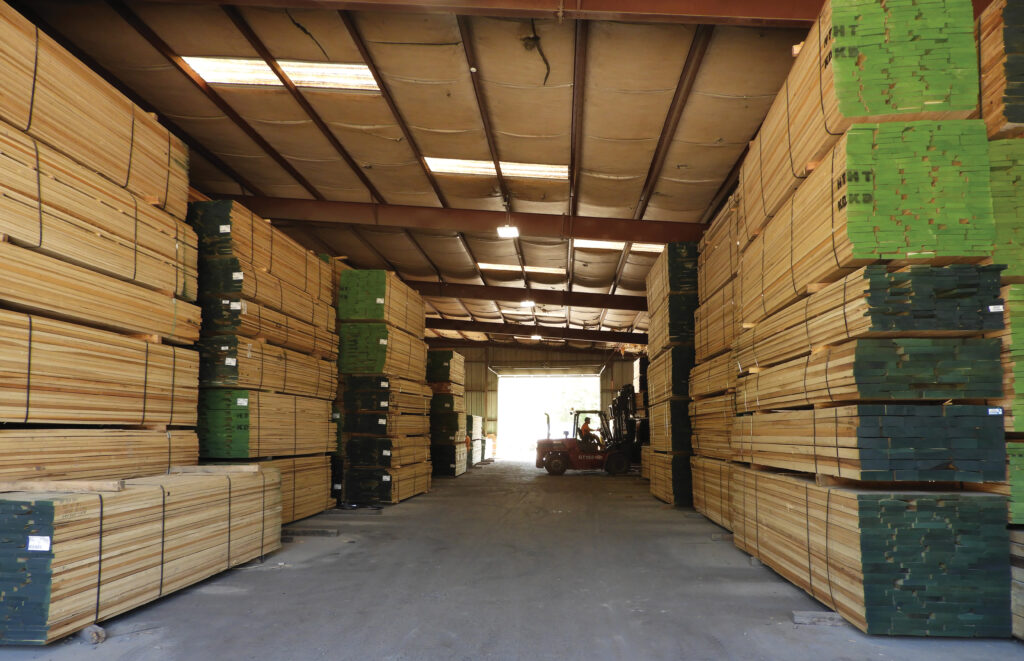 Walnut lumber is stored on the air-dry yard at Prime Lumber.