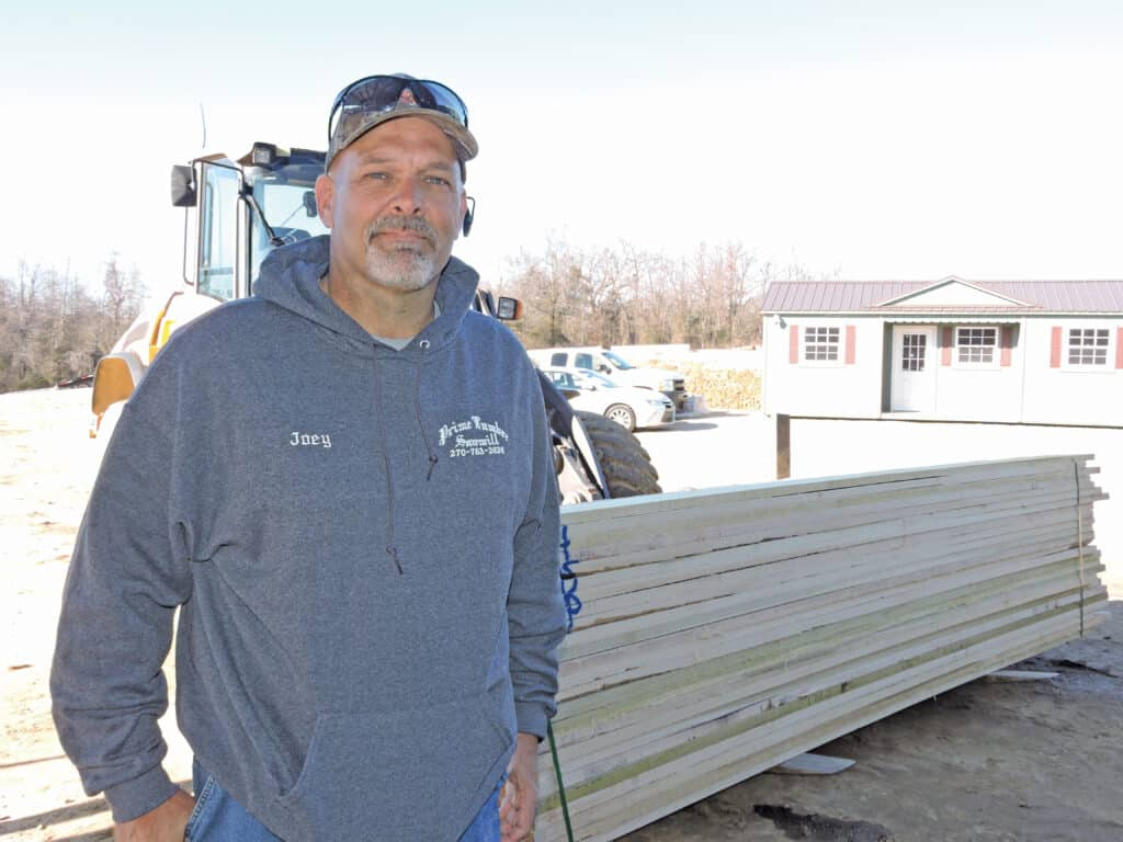 Joey Gray, general manager, stands in front of 5/4 FAS Poplar lumber ready for shipment.