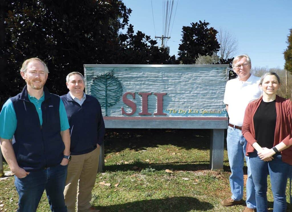 At SII Dry Kilns are, from left, Ben Mathews, vice president of engineering and production; Brian Turlington, vice president of sales; Dan Mathews, president; and Mary Mathews, inside sales / parts manager.