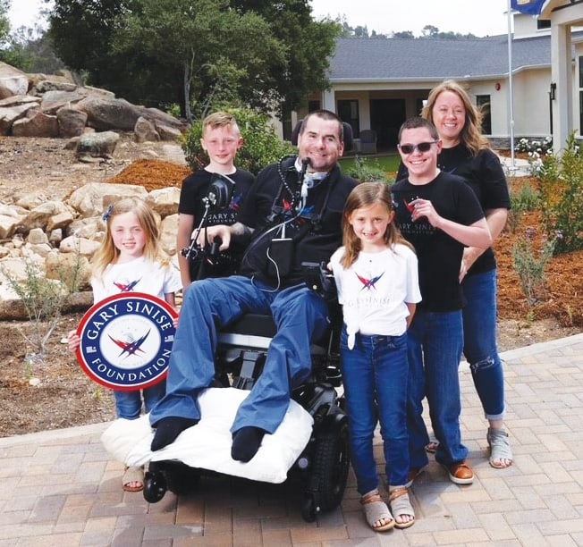 U.S. Navy Senior Chief Petty Officer (Ret.) Kenton Stacy, his wife Lindsey, and their four children: Logan, Mason, Annabelle, and Sadie