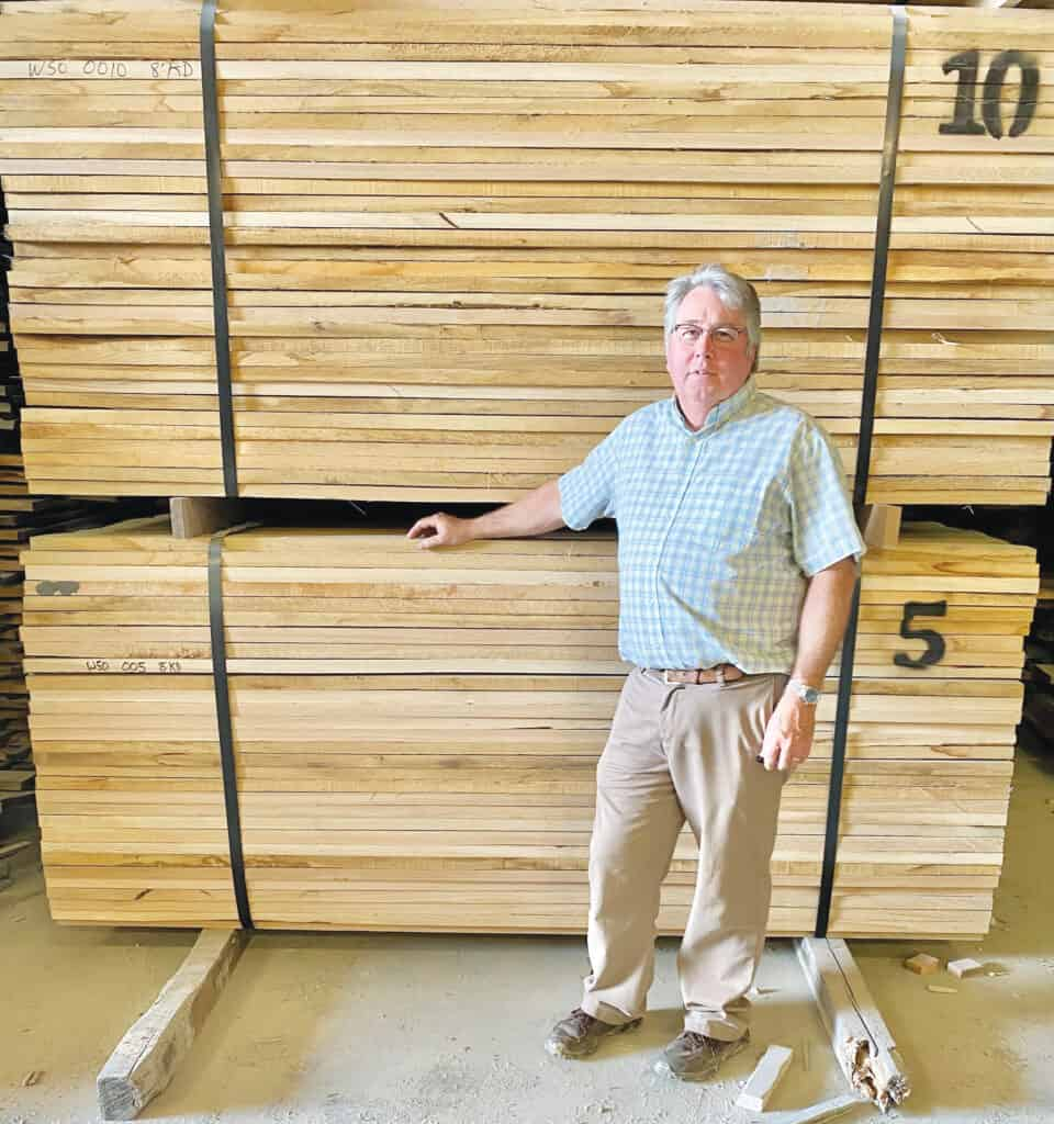 Marty Wood (owner, R&M Wood) stands in front of the company's double end trimmed 5/4 FAS White Oak, ready for shipment. R&M buys 2.5 million board feet of lumber annually.