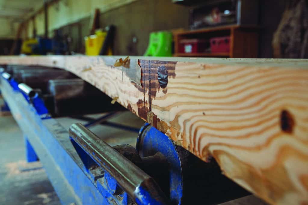 At Calvert Co. Inc.'s Vancouver, Wa, mill, is an example of a beam on the way to the planer in the finish department.