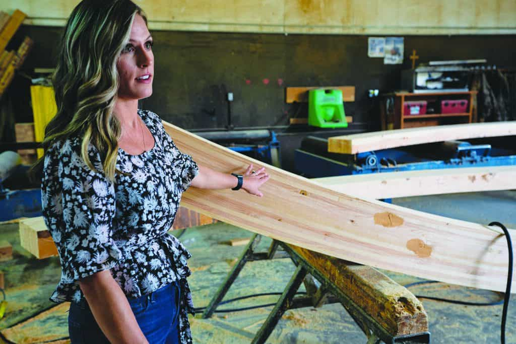 At Calvert Co. Inc.'s Vancouver Mill, Brittany Coltrane, Sales Manager, explains the finishing process for the curved beam shown.