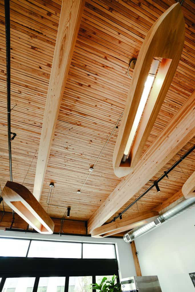 The Hudson Building in Vancouver, WA is a structure built utilizing mass timber from local sources (Calvert Co. Inc. glulam beams are shown here).